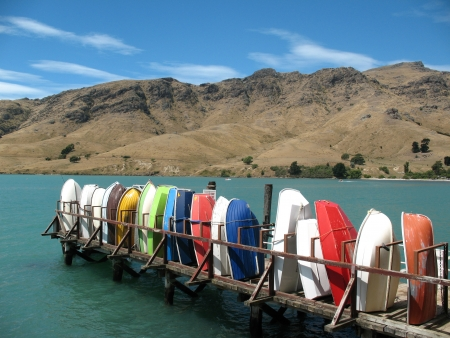 christchurch: Colorful boats along a jetty on Banks Peninsula, Christchurch, New Zealand Stock Photo