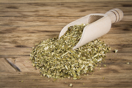 mate infusion: yerba mate on wooden table