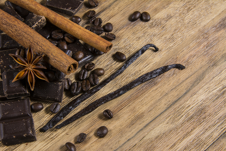 caffe: chocolate with cinnamon and caffe beans on wooden table