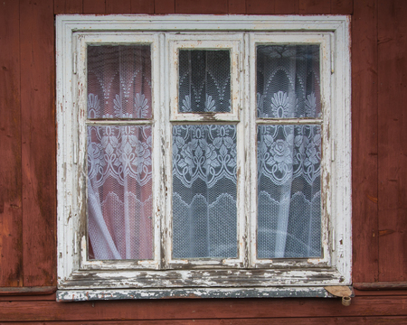 primaeval: Old closed window on a aged wooden wall Stock Photo