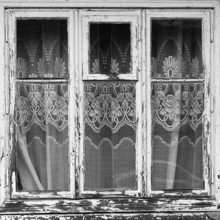 primaeval: closed old window with curtain