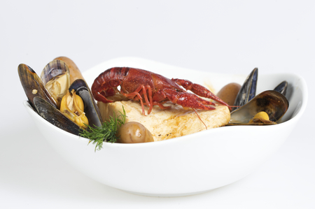 Seafood hot dish in white plate stock photo photo