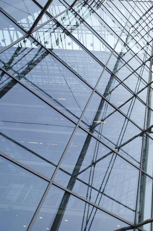 Modern blue glass skyscraper perspective view photo