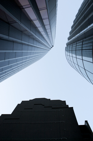 Modern three glass skyscrapers perspective view on the blue sky in London City photo