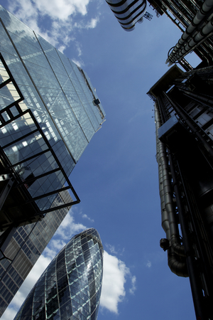 Modern glass skyscrapers perspective view on the blue sky in London City photo