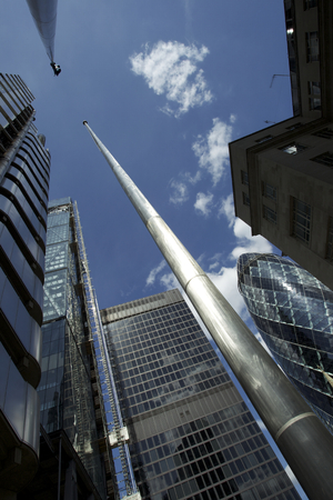 Modern City glassy buildings on the blue sky photo
