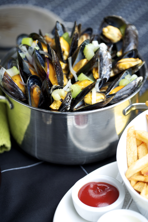 nether: Fresh cooked moule with chips mayo and ketchup Stock Photo
