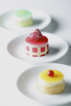 patisserie: Mini patisserie cakes Green Red and Yellow