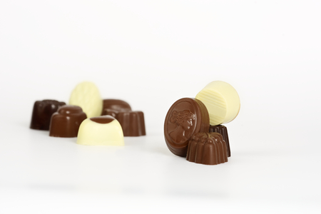 selection of white milk and dark chocolates on white background