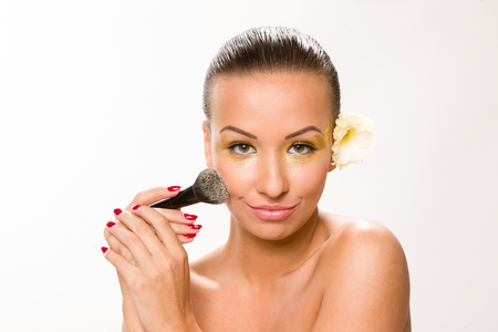 sleek: Make up. Brown sleek hair beautiful woman with fan brush close to face.