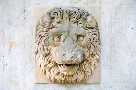 Lions relief in Park Lazienkowski in Warsaw, Poland