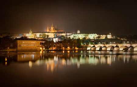 st charles: Charles bridge and St. Vitus cathedral view during rainy night, Prague, Czech republic