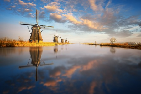 holland windmill: Beautiful sunset view at typical windmill at Kinderdijk, Holland. Stock Photo