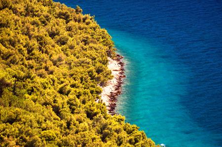 Amazing Kornati archipelago of Croatia. Northern part of Dalmatia. Sunny detail of Stomorski islands. Beautiful summer seascape with clear water from Zadar to Sibenik. Stock Photo