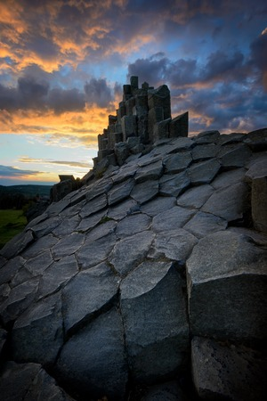 Amazing Chambermaid rock during fiery sunset and beautiful formation of rocks, Central Bohemian Uplands, Czech republic.