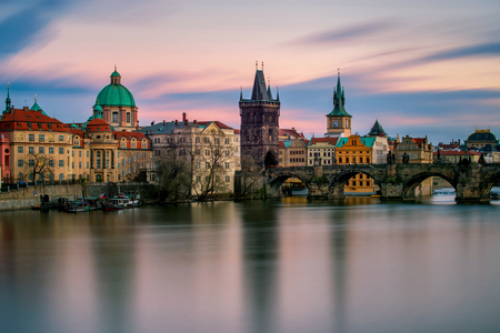 heavy snow: Amazing towers of Charles bridge and old town district with reflection at Vltava river during cloudy sunset, Prague, Czech republic