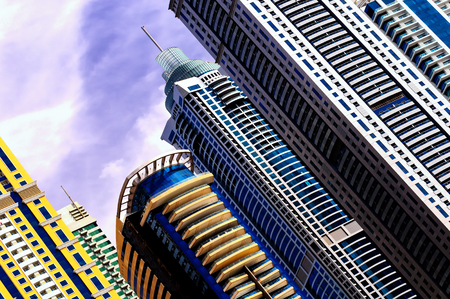 Majestic colorful dubai marina skyscrapers. Detail of world tallest residential buildings. Dubai marina, United Arab Emirates. Stock Photo