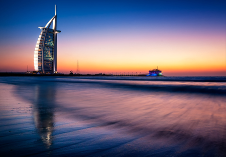 DUBAI, UAE - APR 14, 2013: Famous Jumeirah beach view with 7 star hotel Burj Al Arab, Dubai, United Arab Emirates