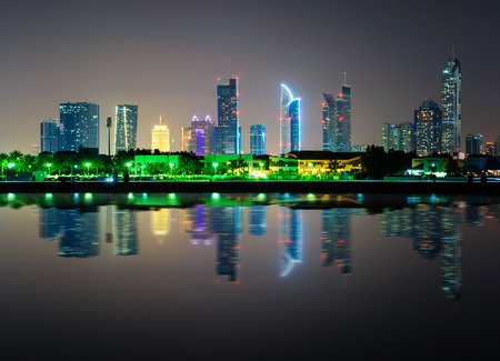 Sheikh: Amazing night dubai downtown skyline with tallest skyscrapers and beautiful Jumeirah beach reflection, Dubai, United Arab Emirates