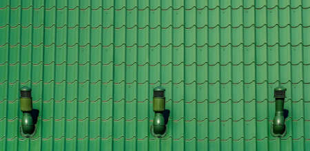 Roof tiles pattern painted green with 3 steel chimes places in symmetrical distance Stock fotó