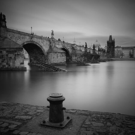 Well-known look to Prague, beautiful Charles Bridge with long exposure in black and white. Stock Photo - 129905066