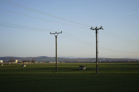 High voltage poles with cables stretched