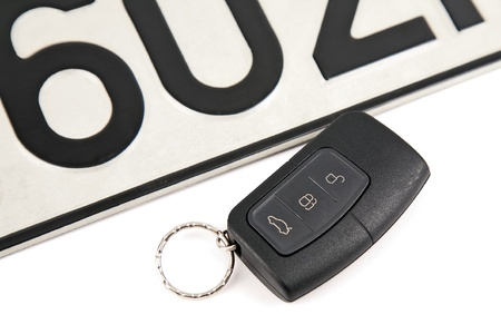 remote controlled car key and registration plate photo