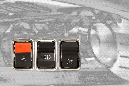 three car dashboard switches photo