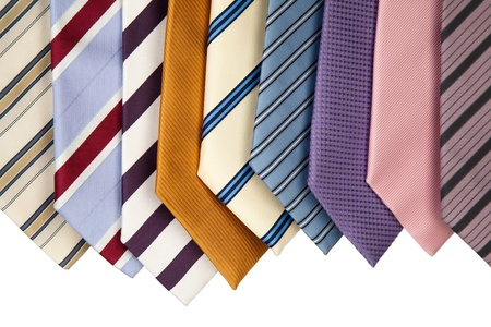 dress code: collection of various colorful neckties for men.