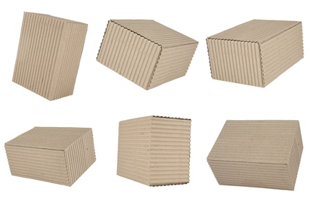six cuboid cardboard boxes on white background photo