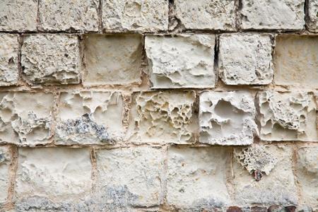 atmospheric phenomena: old wall destroyed by the impact of atmospheric phenomena