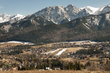 the city Zakopane in the valley and Giewont mountain in the distance  photo
