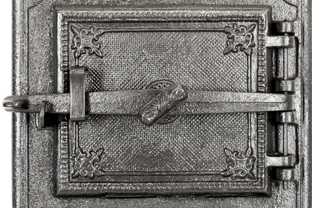door to the tile stove made of cast iron photo