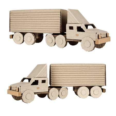 tractor trailer truck made from corrugated board riding in the left and right photo