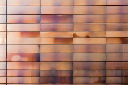 metal panels of modern building facades create interesting industrial background Stock Photo