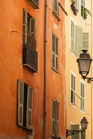 azur: facade of the building in a narrow street of the old town in Nice, France