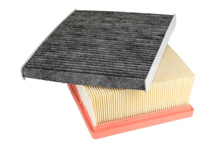 two air filters for different applications in the automotive industry. one cleans the air supplied to the engine and the other protects the passengers against pollen photo