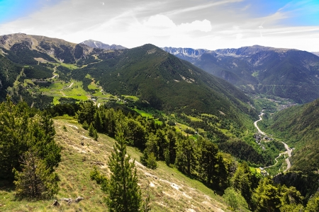 tourism in andorra: Green forested mountains, gentle slopes and beautiful valleys crossed by hiking trails in Andorra Stock Photo