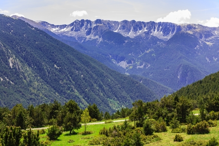 tourism in andorra: Rocky mountains and beautiful forested mountain slopes of the Pyrenees in Andorra