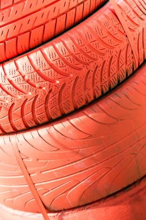 A pile of old tires painted red Stock Photo - 15329926