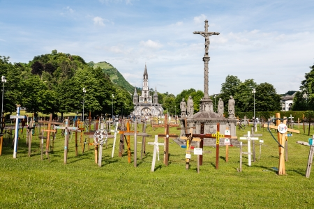LOURDES – JUN 06  The Basilica of our Lady of the Rosary on June 06, 2011 in Lourdes in France  Garden of crosses in front of the Basilica