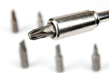 Screwdriver and a few bits can be seen nearby Stock Photo