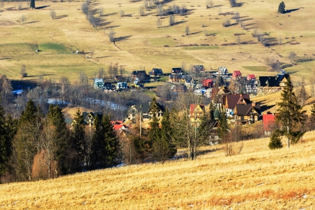 Residential buildings among the fields around Zakopane in Poland Stock Photo - 17355395