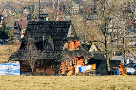 ZAKOPANE - DECEMBER 31: Contemporary wooden house is a kind of typical family home usually with one or more guest rooms for tourists in Zakopane in Poland on December 31, 2012.  Stock Photo - 17435654