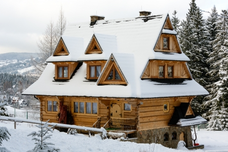 ZAKOPANE - JANUARY 09: House Pod Spadowcem built of solid spruce with larch finish in the regional style in Zakopane in Poland on January 09, 2013. Pod Spadowcem is little guesthouse with 4 rooms. Stock Photo - 17435647