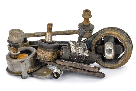 A few old, worn out and rusty car parts photo