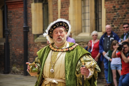 LONDON - JUNE 07: An actor portrays King Henry VIII who was King of England from 1509 to 1547 at Hampton Court Palace in London in United Kingdom on JUNE 07, 2010.