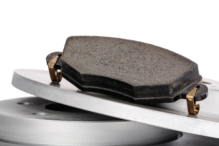 discs: New brake pad and brake discs into the brake system for a modern passenger car shown close up