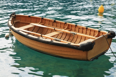 wooden boat: Small fishing boat on the sea water in a secluded bay