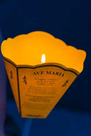 atonement: LOURDES - JUN 05: lantern with a candle at evening daily procession from the Grotto to the front of Basilica of the Rosary and the faithful sing the song Ave Maria in Lourdes, France on June 05, 2012